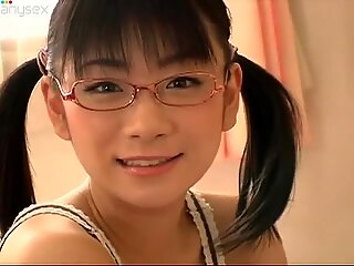 Japanese nerdy girl Ami Tokito in her pink bedroom