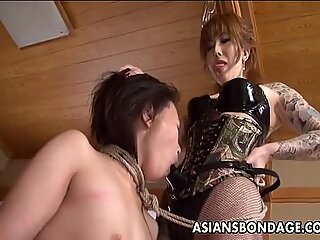Rough Asian mistress nails her tasty slave damsel