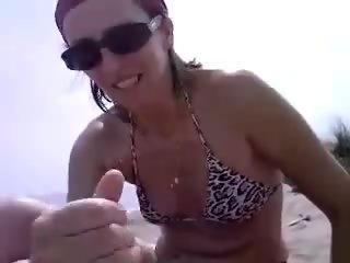 Italian wife jerking cock at public beach