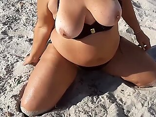 Games in the sand on the beach. Touching Big Tits in the San