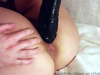 Taking a huge dildo balls deep!