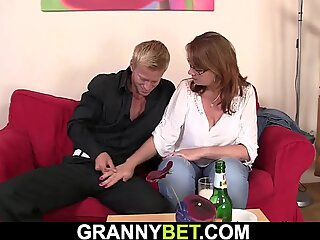 Busty old woman gives head and rides cock