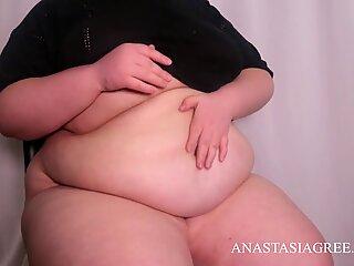 Sensual touches to the big tummy