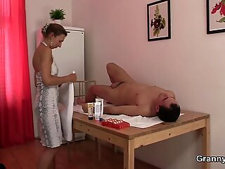 60 years old masseuse pleases her client
