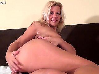 Mature blonde MILF pounding her MILF cunt
