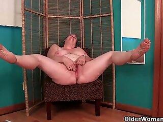 Busty grandma in nurse uniform and stockings masturbates