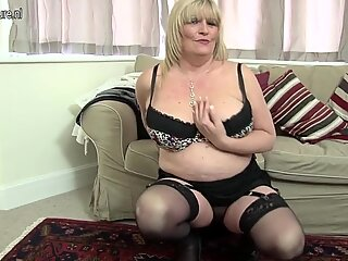 Hot British mother shows her great tits and masturbates