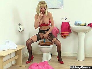 British grannies Elaine and Amanda fuck a dildo on toilet