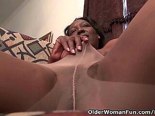 black grandmother Amanda disrobes her pantyhose and plays