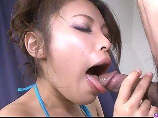 Asian babe Yurika Gotou humming on a guys flesh flute