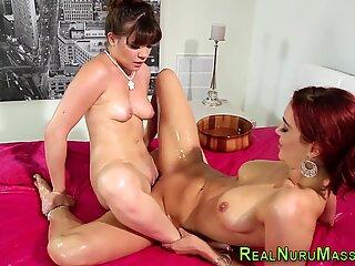 Lesbian masseuse rubbing