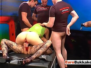Multiple men take turns to drill horny brunette as they piss on her