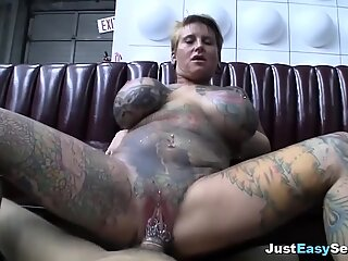 Blonde plumper wrapped in tattoos rides hard cock