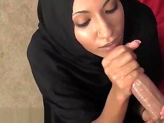 Arabian beauty strokes a throbbing cock