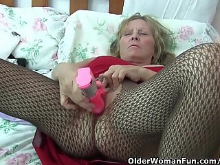 Granny With Big Tits Wears stocking As She boinks A dildo