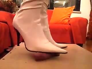My wife plays with my cock in her new white boots