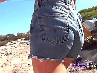 Hot Italian Girl Upskirt on the beach with Bikini Wedgie and Tattoos