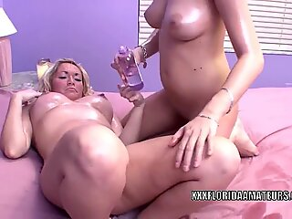 Lesbo coeds Celeste and Chaydin get kinky with oil
